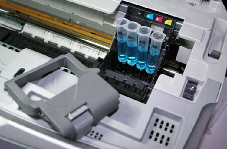 почему печатает с полосами принтер canon