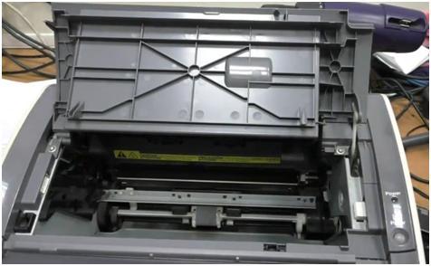 как вытащить бумагу из принтера кэнон